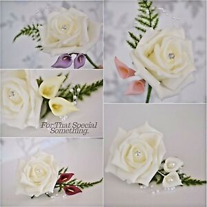 Wedding buttonhole Corsage rose flower. White ivory calla lily with fern leaf