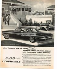 1961 OLDSMOBILE F-85 Cutlass 2-door Coupe at Train Station art Vtg Print Ad