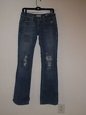 TAVERNITI SO JIMMY DISTRESSED PATCHES LOW RISE PEGGY BOOTCUT STRETCH JEANS 28