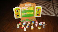 VINTAGE STRAWBERRY SHORTCAKE  DISPLY CASE AND 15 FIGURES
