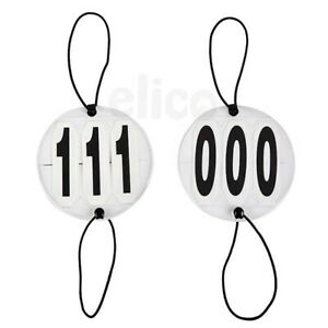 ONE PAIR OF BRIDLE NUMBERS THREE DIGITS FOR COMPETITION DRESSAGE