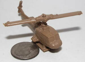 Small Plastic UH-1 Huey Helicopter in Tan