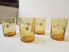 4 anciens petits verres orangés emaillés fleurettes