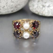 Ring mit Granat Steinen und Zuchtperlen in 333/8K Gelbgold