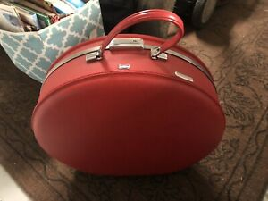 AMERICAN TOURISTER ROUND RED VINTAGE LUGGAGE