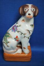 A lovely vintage porcelain sitting dog figure, floral decoration, Oriental mark