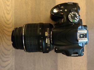 Nikon D D5100 16.2MP Digital SLR Camera - Black (Kit with VR 18-55 mm Lens)