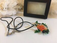 Frog necklace with flowers in its body glass frog necklace with black rope chain