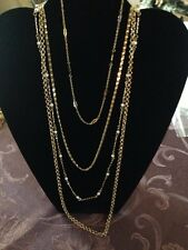 PRETTY GOLD TONED FOUR STRAND CHAIN NECKLACE WITH IMITATION PEARLS