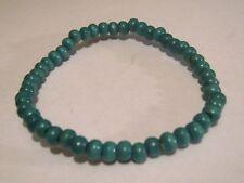 Lovely lightweight elasticated wooden mini beaded bracelet turquoise