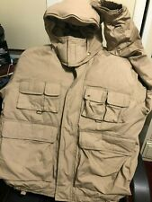 A universal Fishing and hunting jacket, pockets front and back hooded