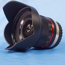 Samyang Rokinon 12 mm / 2.0 + lens hood + Nisi UV filter. Superb condition