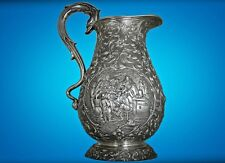 An Artistic Tenieres Style Dutch Solid Silver Pitcher