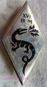 IN11442 - INSIGNE XVI° Brigade Motorisée, dos guilloché, pastille oblongue