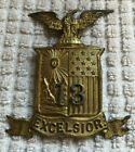 U.S. INDIAN/SPANISH AMERICAN WAR EXCELSIOR HELMET PLATE INSIGNIA, NEW YORK, 13TH