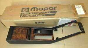 NOS Mopar 4410047 center console trim plate bezel 1987 88 1989 Chrysler LeBaron
