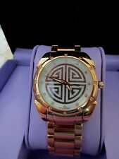 ROSE GOLD-PLATED STAINLESS STEEL WRISTWATCH .15 DIAMONDS..MOP-SWISS MOV...BRODIE