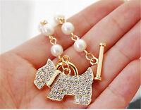 Gold tone crystal dog puppy charm bracelet