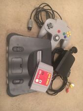 Nintendo 64 console with mission impossible game