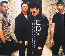 """U2 """"STUCK IN A MOMENT YOU CAN'T GET OUT OF"""" cd's"""