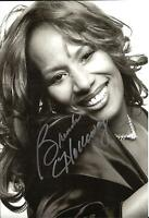 A 12 x 8 inch photo featuring & personally signed by Soul Singer Brenda Holloway