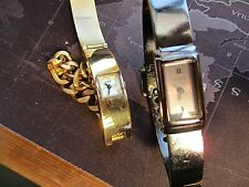 pair two guess  quartz watches,,running   used with age