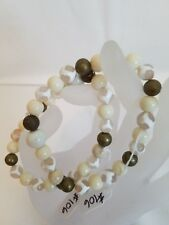 Handcrafted beaded cream jade and crab agate with bronze accent stretch bracelet
