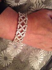 (77B) Missing  stone  £39.99 kiss x simulated diamond silver plated Bracelet