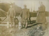 Vintage photo of soldiers standing next to an aircraft during the World War I in