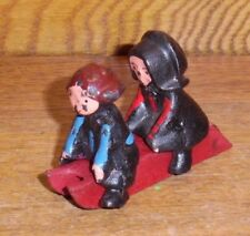 Vintage Miniature Cast Iron Amish Boy & Girl On Red Sled