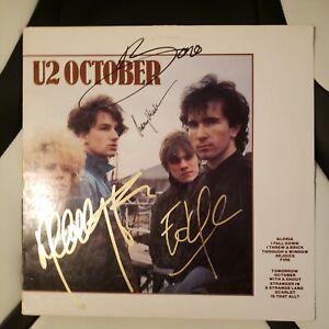 U2 signed vinyl album OCTOBER by 4 Artists