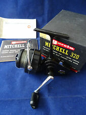 A VERY GOOD BOXED VINTAGE MITCHELL 320 SPINNING REEL WITH BOOKLET ETC.