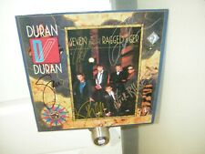 Duran Duran signed lp **Seven and the Ragged Tiger **5 members **1983**