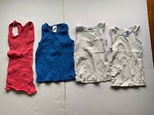 4 singlets. blue, white, pink. size 1-2 years