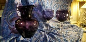 Hand blown purple glass pitcher and goblet glasses