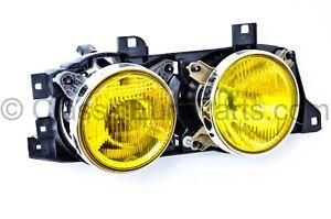 Euro BMW E32 / E34 Original yellow French smiley ellipsoid headlight Right NOS