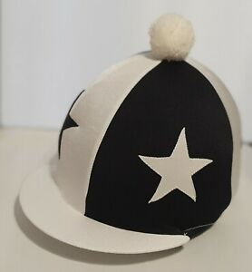 RIDING HAT COVER - WHITE QUARTERS WITH LARGE SEWN BLACK STARS & WHITE POMPOM
