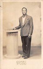 BLACK MAN IN SUIT, STUDIO POSED IMAGE, CORBIT OF BRIDGEPORT CT RPPC c. 1940's