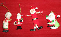 3 plastic or resin Santa's 1 Mrs Claus Christmas Ornaments