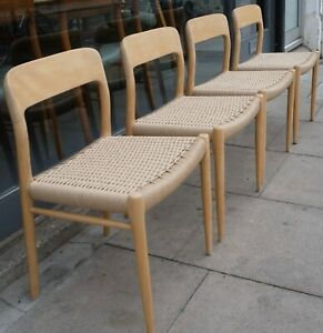 Four vintage 1970s Danish Oak Moller 75 dining chairs with paper cord seats