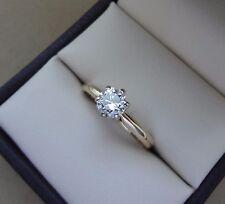 14K YELLOW GOLD .56 CARAT ROUND BRILLIANT DIAMOND ENGAGEMENT RING