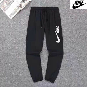 Nike Mens Loge Joggers Tracksuit Bottoms Trousers With Zipper Pockets