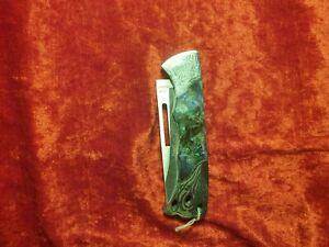 Taschenmesser, Griff mit Ornamenten verziert, Griffschalen Kunststoff.