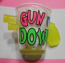 """Gun It Down"" Yellow 3D Gun Sticking out on Both Sides of Shot Glass"