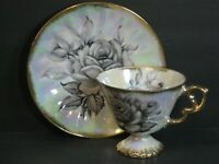 VTG Ucagco Iridescent Footed Teacup & Saucer Large Roses Black/Gray, Gold, Japan