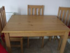 Modern kitchen / dinning table and four chairs  light wood colour little used