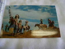 INDIANS ON THE MARCH  ON HORSES WITH CEREMONIAL COSTUMES  POSTCARD