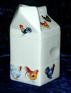 Milk carton shaped jug off white ceramic decorated with  chickens, cockerel hens