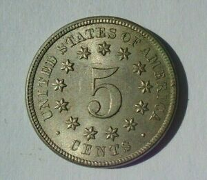 US 5c nickle coin year date 1869 with error gaps in D and S of United States AU+