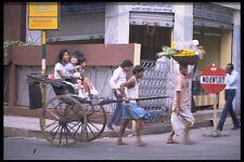 512053 Rickshaw Driver On A Street In Calcutta India A4 Photo Print
